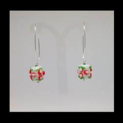 Silver earrings and glass...